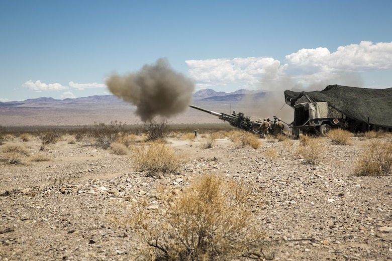 Marines with 3rd Battalion, 10th Marine Regiment, 2nd Marine Division, fire a 155mm M777A2 Light-weight Towed Howitzer in the Black Top Training Area aboard Marine Corps Air Ground Combat Center Twentynine Palms, Calif., May 18, 2016. Various units from 2nd Marine Division participated in Integrated Training Exercise 3-16 in preparation for their deployment with Special Purpose Marine Air Ground Task Force-Crisis Response-Africa. (Official Marine Corps photo by Lance Cpl. Levi Schultz/Released)