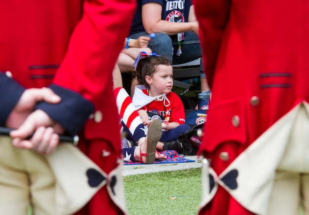 A child looks on as the Old Guard Fife and Drum Corp prepares to perform during the Tragedy Assistance Program for Survivors (TAPS) National Military Survivors Seminar and Good Grief Camp in Crystal City, Va., on May 29. TAPS is an organization that provides support to people who are affected by the death of a military service member. (U.S. Army photo by Spc. Victoria Friend)
