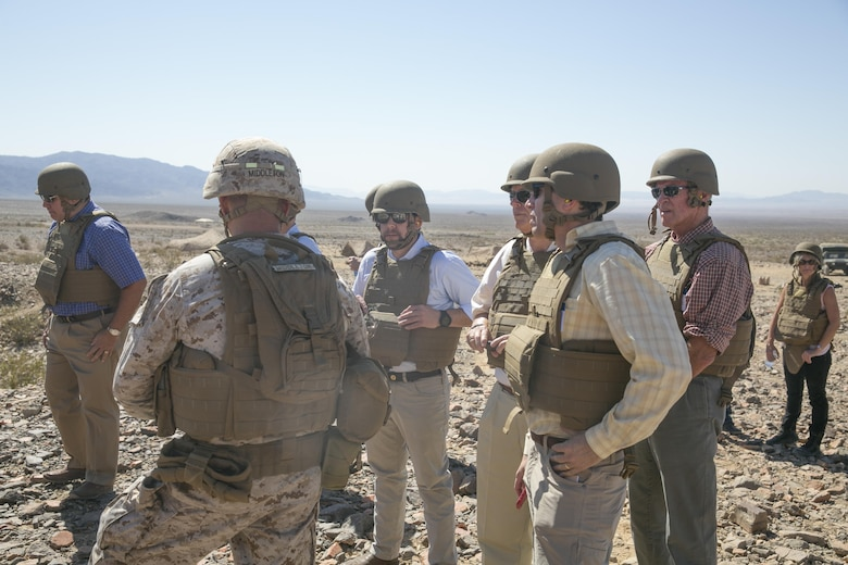 Member of Business Executives for National Security talk with Lt. Col. Brian Middleton, commanding officer, 3rd Battalion, 4th Marines, 7th Regiment, during a live-fire exercise held at Range 410 aboard Marine Corps Air Ground Combat Center, Twentynine Palms Calif., May 19, 2016. (Official Marine Corps photo by Cpl. Thomas Mudd/Released)