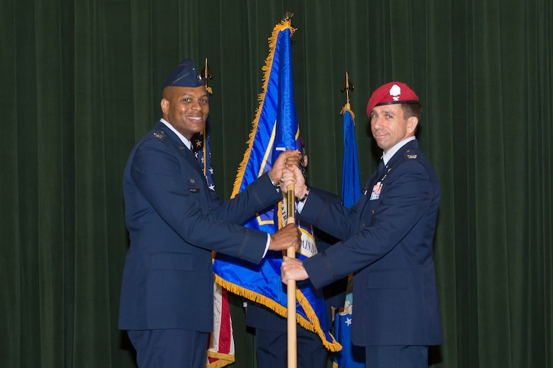 Col. Roy Collins, commander of the 37th Training Wing, passes the Battlefield Airman Training Group guidon to Col. Ronald Stenger, the inaugural commander of the BA TG, during the BA TG activation ceremony June 2, 2016, at Joint Base San Antonio-Lackland, Texas. The BA TG encompasses five subordinate squadrons, whose members will train the Air Force's conventional and special operations ground forces, including combat controllers, pararescuemen, special operations weathermen and tactical air control party Airmen. The vision of the group is to become the recognized leader among the special operations forces selection and training community while driving human performance innovation for tactical athletes.