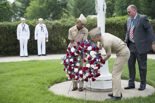 From left: Manpower, Personnel, Training and Education Fleet Master Chief (AW/SW) April D. Beldo, Naval Surface Warfare Center Carderock Division (NSWCCD)Commanding Officer Capt. Rich Blank and NSWCCD Veterans Employee Resource Group Coordinator Kevin Mook place a wreath at the base of the flag pole during the Memorial Day wreath-laying ceremony in West Bethesda, Md., May 31, 2016. (U.S. Navy photo by Devin Pisner/Released)