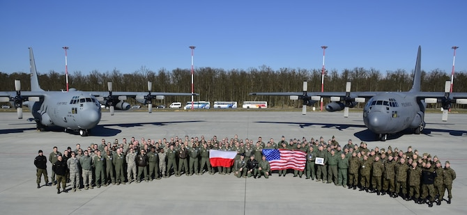 934th Airlift Wing members pose with members of the Polish Air Force at Powidz AB, Poland.
