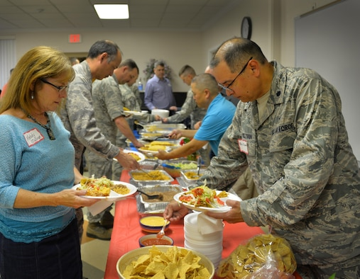 Melody O'Sullivan and Chaplain (Lt. Col.) William O'Sullivan, 82nd Training Wing chaplain, plate their food, provided by Mike Winslow, Air Force Association Gen. Charles L. Donnelly Chapter 284 president, at the Key Spouse Dinner at Sheppard Air Force Base, Texas, May 24, 2016. The O'Sullivan enjoy their first Key Spouse Dinner after recently arriving at Sheppard. (U.S. Air Force photo/2nd Lt. Brittany Curry)