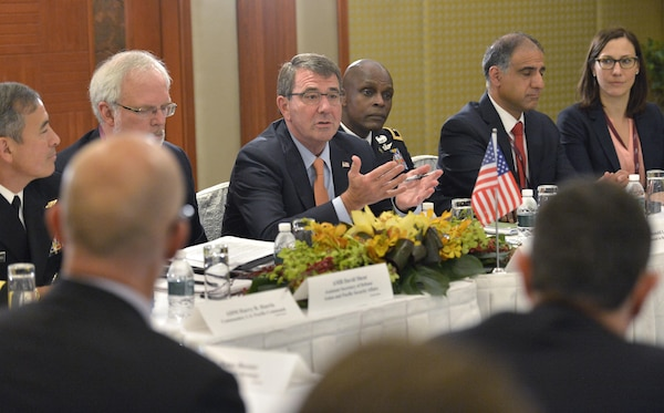Defense Secretary Ash Carter hosts a meeting with Australian Defense Minister Kevin Andrews and Japanese Defense Minister Gen Nakatani at the Shangri-La Dialogue in Singapore, May 30, 2015. At the 2016 dialogue, the defense secretary will deliver a keynote address and meet with Singapore officials. DoD photo by Glenn Fawcett