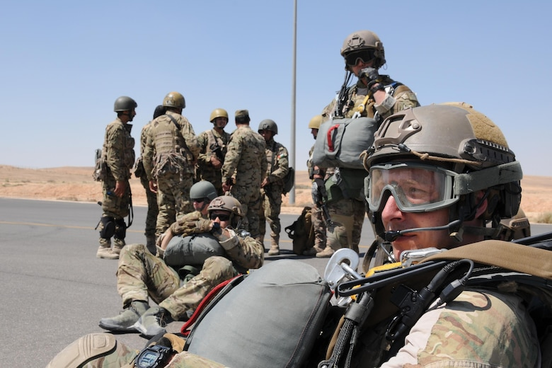 Special Tactics Airmen and Royal Jordanian Armed Forces paratroopers wait to board a 94th Airlift Wing C-130 for an airdrop mission supporting Exercise Eager Lion in Jordan, May 19, 2016. Special Tactics Airmen, the Air Force's ground special operations force, establish air fields and drop zone for follow-on forces after freefalling in to infiltrate into hostile or austere territory. (U.S. Air Force photo/Staff Sgt. Alan Abernethy)
