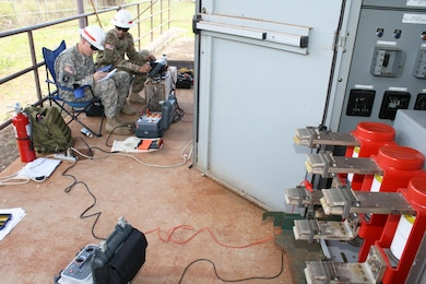 HELEMANO MILITARY RESERVATION, Hawaii (May 24, 2016) --   Power Station Mechanic Sgt. Issac Lower (left) and Electrician Sgt. Jonathan Medina test and verify electrical breaker circuitry at the Helemano substation during a two-week scheduled maintenance in support of the USAG-Hawaii Directorate of Public Works.