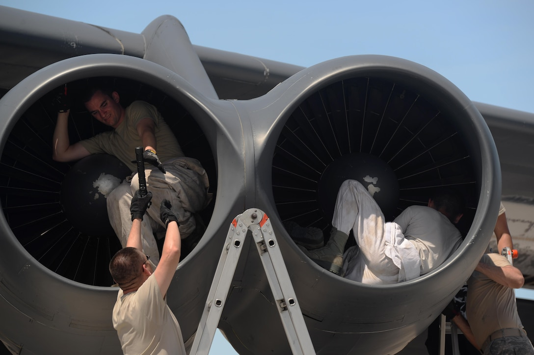 Members of the 36th Expeditionary Aircraft Maintenance Squadron conduct a post-flight inspection on a B-52 Stratofortress after its arrival June 2, 2016, at Andersen Air Force Base, Guam. The U.S. Pacific Command has maintained a rotational strategic bomber presence in the region for more than a decade. These aircraft and the men and women who fly and support them provide a significant capability that enables U.S. readiness and commitment to deterrence, provides assurances to allies, and strengthens regional security and stability in the Indo-Asia-Pacific region. (U.S. Air Force photo by Airman 1st Class Alexa Ann Henderson/Released)