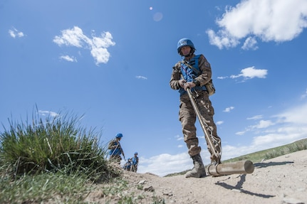 160601-N-WI365-075 ULAANBAATAR, Mongolia (June 01, 2016) – A soldier with the Mongolian Armed Forces inspects for land mines during a mine clearance and counter-improvised explosive device training course at Five Hills Training Area, Mongolia. The 10-day course is part of Khaan Quest 2016 and is designed to increase MAF soldiers' capability in detecting unexploded ordnance and mine awareness skills that can be used during deployments or peacekeeping missions. Khaan Quest 2016 is an annual, multinational peacekeeping operations exercise hosted by the Mongolian Armed Forces, co-sponsored by U.S. Pacific Command, and supported by U.S. Army Pacific and U.S. Marine Corps Forces, Pacific. Khaan Quest, in its 14th iteration, is the capstone exercise for this year's Global Peace Operations Initiative program. The exercise focuses on training activities to enhance international interoperability, develop peacekeeping capabilities, build mil-to-mil relationships, and enhance military readiness. (U.S. Navy photo by Mass Communication Specialist 3rd Class Markus Castaneda/RELEASED)