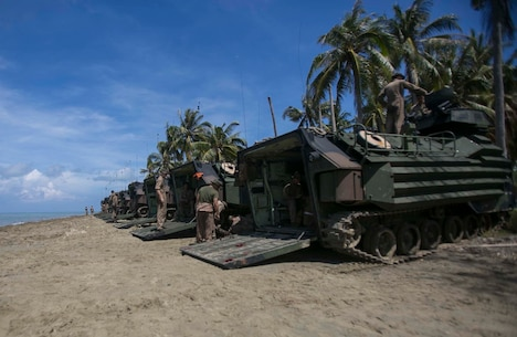 TANDUO BEACH, MALAYSIA (May 30, 2016) – U.S. Marines assigned to Easy Company, Battalion Landing Team, 2nd Battalion, 2nd Marines, let down ramps of Amphibious Assault vehicles after an amphibious transition from ship to shore. The Marines are embarked with U.S. Sailors aboard the USS Ashland (LSD 48) in support of exercise Cooperation Afloat Readiness and Training. CARAT is a series of annual, bilateral maritime exercises between the U.S. Navy, U.S. Marine Corps and the armed forces of nine partner nations to include Bangladesh, Brunei, Cambodia, Indonesia, Malaysia, Singapore, the Philippines, Thailand and Timor-Leste. The Ashland is assigned to U.S. 7th Fleet.  (U.S. Navy photo by Lance Cpl. Carl King Jr/. Released)