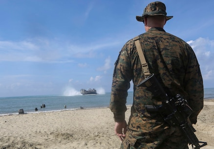 TANDUO BEACH, MALAYSIA (May 30, 2016) – U.S. Marine Corps Major Sven Jensen, the Commander of troops for Easy Company, Battalion Landing Team 2nd Battalion, 2nd Marines watches as an LCAC brings in supplies during an amphibious transition from ship to shore. The Marines of Easy Co., BLT, 2/2 are embarked with U.S. Sailors aboard the USS Ashland (LSD 48) in support of exercise Cooperation Afloat Readiness and Training. CARAT is a series of annual, bilateral maritime exercises between the U.S. Navy, U.S. Marine Corps and the armed forces of nine partner nations to include Bangladesh, Brunei, Cambodia, Indonesia, Malaysia, Singapore, the Philippines, Thailand and Timor-Leste. The Ashland is assigned to U.S. 7th Fleet. (U.S. Navy photo by Lance Cpl. Carl King Jr/. Released)