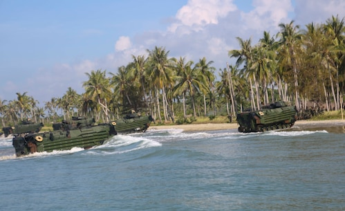 TANDUO BEACH, MALAYSIA (May 30, 2016) – U.S. Marines assigned to Easy Company, Battalion Landing Team, 2nd Battalion, 2nd Marines conduct an amphibious transition from ship to shore. The Marines are embarked aboard the USS Ashland (LSD 48) in support of exercise Cooperation Afloat Readiness and Training. CARAT is a series of annual, bilateral maritime exercises between the U.S. Navy, U.S. Marine Corps and the armed forces of nine partner nations to include Bangladesh, Brunei, Cambodia, Indonesia, Malaysia, Singapore, the Philippines, Thailand and Timor-Leste.The Ashland is assigned to U.S. 7th Fleet. (U.S. Navy photo by Lance Cpl. Carl King Jr/. Released)