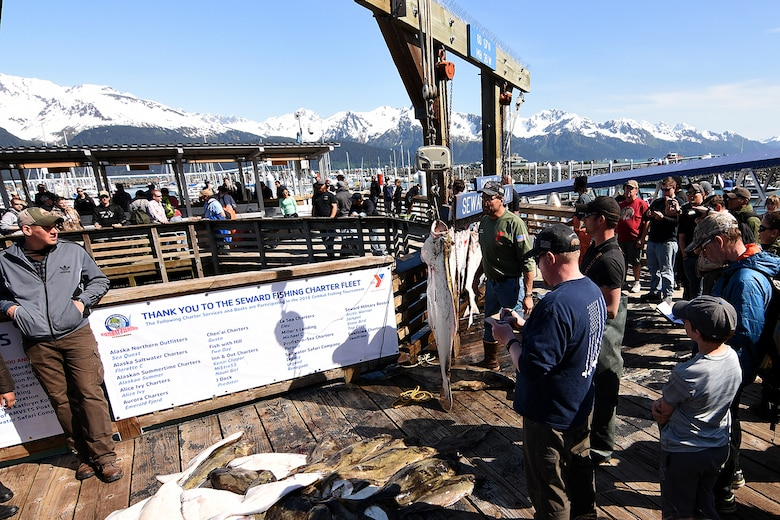 Spectators crowd around the official weigh-in point for the 10th Annual Armed Services Combat Fishing Tournament in Seward, Alaska, May 26. The tournament, hosted by the city of Seward and the Armed Services YMCA, gave more than 200 military anglers stationed in Alaska a free day of halibut fishing to thank them for their service. (U.S. Army photo by John Pennell)