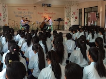 The USAF Strings perform for students at the Don Bosco Technical School in Phnom Penh.  (U.S. Air Force Photo/SSgt Benjamin Landon)