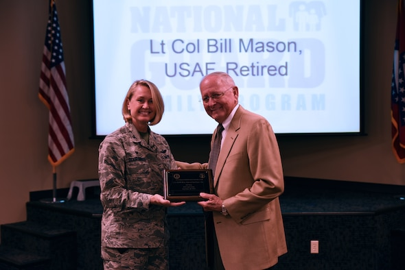 Ret. Lt. Col. Bill Mason receives the Extra Mile Award from Col. Bobbi Doorenbos, 188th Wing commander, May 15, 2016, during commander's call at Ebbing Air National Guard Base, Fort Smith, Ark. Mason has provided numerous hours of service by overseeing the 188th Old Guard, working with current members to sponsor the annual Christmas luncheon that averages 400 current and former members of the 188th, assisting with the Wing's 60th Anniversary by capturing data for the history book and has gone above and beyond for current and former members of the 188th. (U.S. Air National Guard photo by Senior Airman Cody Martin/Released)