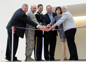 From left-to-right, Erich Ledebuhr, Hanscom Middle School principal; Col. David Dunklee, installation commander; Lt. Col. Daniel Herlihy, U.S. Army Corps of Engineers New England District deputy commander; Jonathan Braley, J & J Contractors president; Jennifer Glass, Lincoln School Committee chair; and Dr. Rebecca McFall, Lincoln superintendent of schools, prepare to cut a ribbon to mark the completion of a $34 million Hanscom Middle School on base June 2. The new school replaces a 1950s-era building with 21st Century Learning methods. (U.S. Air Force photo by Linda LaBonte Britt)