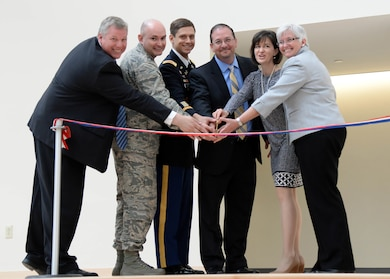 Lt. Col. Daniel Herlihy, U.S. Army Corps of Engineers New England District deputy commander (3rd from left), and several local and base officials prepare to cut a ribbon to mark the completion of a $34 million Hanscom Middle School on base June 2. The new school replaces a 1950s-era building with 21st Century Learning methods. (U.S. Air Force photo by Linda LaBonte Britt)