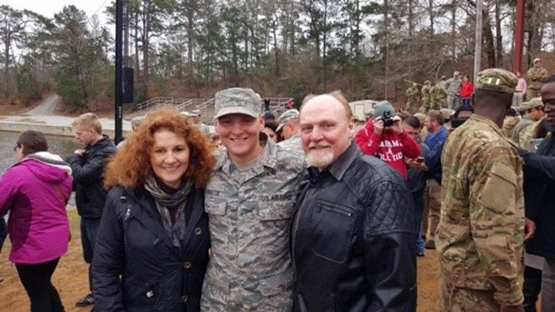 U.S. Air Force Senior Airman Maxwell Martin, reaction force leader assigned to the 633rd Security Forces Squadron, embraces his parents after graduating Ranger School at Fort Benning, Ga., March 4, 2016. Martin was the only Airman to graduate in his class. (Courtesy Photo)