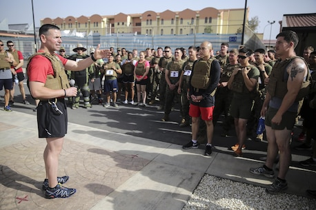 Lt. Col. Randall Jones, the commanding officer of the Logistics Combat Element for Special Purpose Marine Air-Ground Task Force Crisis Response-Africa, speaks to Marines and sailors before the Memorial Day Murph challenge at Naval Air Station Sigonella, Italy, May 30, 2016.  Marines and sailors ran one mile, completed 100 pull-ups, 200 push-ups, 300 air squats and another one-mile run, all while wearing a flak jacket.  (U.S. Marine Corps photo by Cpl. Alexander Mitchell/released)