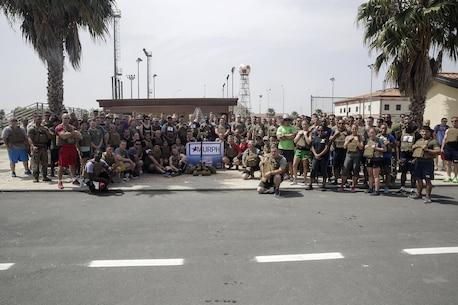 Marines and sailors with Special Purpose Marine Air-Ground Task Force Crisis Response-Africa, pose for a group photo after completing the Memorial Day Murph challenge at Naval Air Station Sigonella, Italy, May 30, 2016.  Participants in the event ran one mile, completed 100 pull-ups, 200 push-ups, 300 air squats and another one-mile run, all while wearing a flak jacket.  (U.S. Marine Corps photo by Cpl. Alexander Mitchell/released)