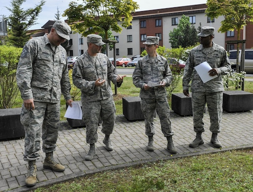 Judges inspect a dorm May 17, 2016, at Ramstein Air Base, Germany. The dorm of the quarter awards are a new incentive that recognize Airmen for their hard work in keeping their living areas clean and encourages them to continue to maintain a high standard of living during their tours here. (U.S. Air Force photo/Senior Airman Larissa Greatwood)