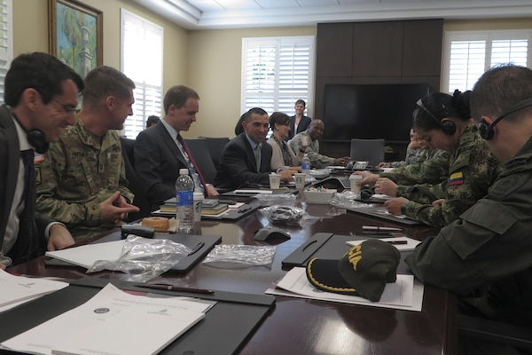 Seven members of the Colombian military meet with the University of South Carolina's Rule of Law Collaborative in Columbia, S.C., May 23, during a Subject Matter Expert Exchange with the South Carolina National Guard's State Partnership Program. The week-long information exchange with Colombian military and National Police legal experts focused on human rights and operational law.