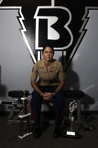 Staff Sgt. Annemarie E. Baker poses for a photo in the gym where she trained to win her first bodybuilding competition. Baker, a 14-year Marine and mother, attributed her decision to compete to her military career.
