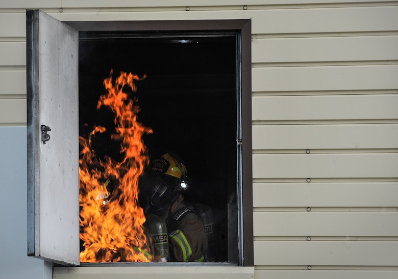 Airmen from the 86th Civil Engineer Squadron put out a fire during a biannual training exercise June 2, 2016, at Ramstein Air Base, Germany. These exercises prepare Airmen for real-world fires and emergencies. (U.S. Air Force photo/Senior Airman Larissa Greatwood)