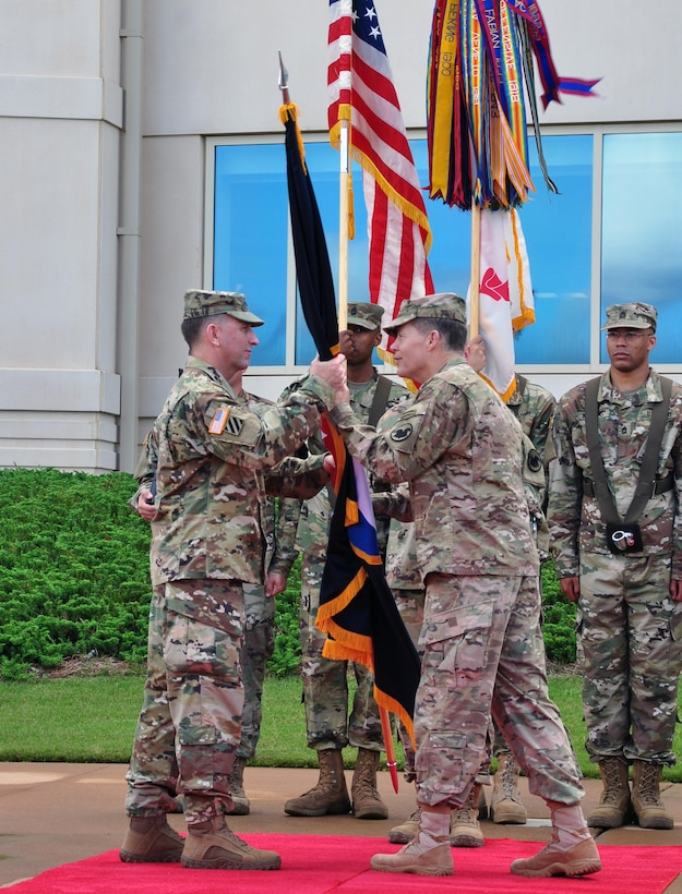 Lt. Gen. Jeffrey W. Talley, commanding general for U.S. Army Reserve Command, relinquishes the command flag to Gen. Robert Abrams, commanding general of U.S. Army Forces Command during a relinquishment of command ceremony held outside Marshall Hall at Fort Bragg, N.C. on 1 Jun.