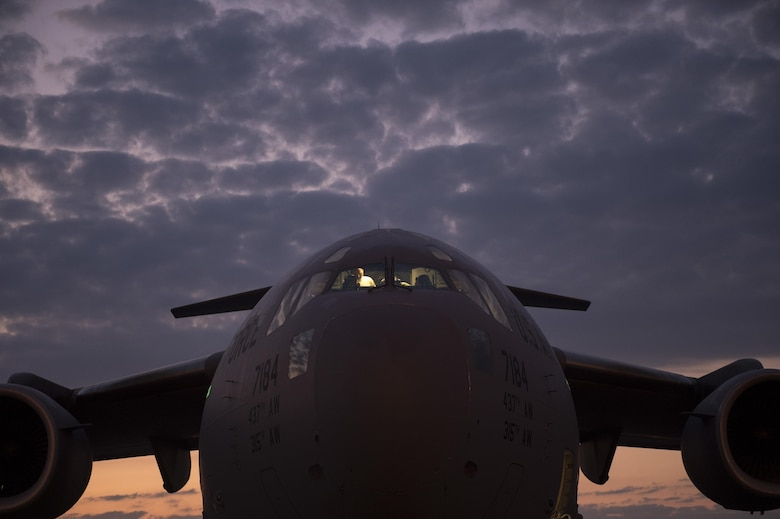 Airmen from the 315th Airlift Wing work to prepare a C-17 Globemaster III for an airdrop mission with Soldiers from the 82nd Airborne Division during exercise Crescent Reach 16 on May 26, 2016, at Joint Base Charleston, S.C. Crescent Reach is an annual exercise designed to test and evaluate Joint Base Charleston's ability to mobilize and launch a large-scale aircraft formation in addition to training, processing and deploying Airmen and cargo in response to a simulated crisis abroad. (U.S. Air Force photo/Tech. Sgt. Jason Robertson)
