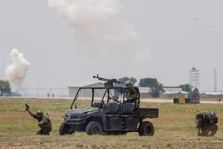 Members of the 27th Special Operations Security Forces Squadron participate in a capabilities demonstration during the Cannon Air Show on May 29, 2016, at Cannon Air Force Base, N.M. The 2016 Cannon Air Show highlights the unique capabilities and qualities of Cannon's air commandos and also celebrates the long-standing relationship between the 27th Special Operations Wing and the local community.  (U.S. Air Force photo/Master Sgt. Dennis J. Henry Jr.)