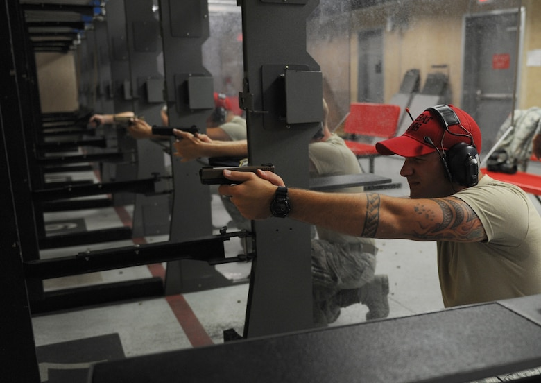 Staff Sgt. Jeffrey Tuscany, an 81st Security Forces Squadron combat arms instructor, fires his weapon during the 81st SFS Law Enforcement Team Competition May 18, 2016, at Keesler Air Force Base, Miss. The competition was held during National Police Week, which recognizes the service of law enforcement men and women who put their lives at risk every day. (U.S. Air Force photo/Kemberly Groue)