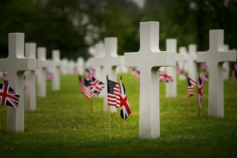 Hundreds gathered May 30, 2016, at Madingley American Cemetery in Cambridge, England, to honor thousands of U.S. Soldiers, Sailors, Marines and Airmen who made the ultimate sacrifice. The cemetery contains 3,812 headstones and a Wall of the Missing, which stands nearly 500 feet in length and contains the names of more than 5,000 men from the U.S. Army, Army Air Corps, Navy, Marine Corps and Coast Guard, who are still listed as missing in action, buried at sea or unaccounted for. (U.S. Air Force photo/Tech. Sgt. Matthew Plew)