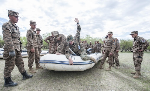 160530-N-WI365-037 ULAANBAATAR, Mongolia (May 30, 2016) – U.S. Marine Sgt. Nate Hitchcock, assigned to 3rd Reconnaissance Battalion, demonstrates proper hand gestures and signals to members of the Mongolian Armed Forces while aboard a combat rubberized raid craft (CRRC) during a small boat riverine training course. The small boat riverine training course is part of Khaan Quest 2016 and is the continuation of last week's basic water survival course to familiarize MAF soldiers with different survival tactics in different environments that can be used during their deployment or U.N. missions. Khaan Quest 2016 is an annual, multinational peacekeeping operations exercise hosted by the Mongolian Armed Forces, co-sponsored by U.S. Pacific Command, and supported by U.S. Army Pacific and U.S. Marine Corps Forces, Pacific. Khaan Quest, in its 14th iteration, is the capstone exercise for this year's Global Peace Operations Initiative program. The exercise focuses on training activities to enhance international interoperability, develop peacekeeping capabilities, build to mil-to-mil relationships, and enhance military readiness. (U.S. Navy photo by Mass Communication Specialist 3rd Class Markus Castaneda/RELEASED)