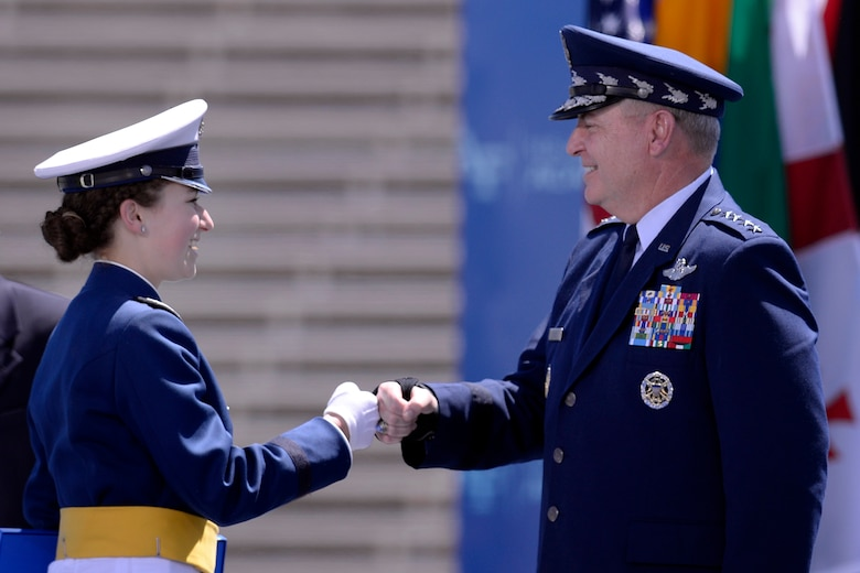 Air Force Chief of Staff Gen. Mark A. Welsh III congratulates Cadet 1st Class Amy Silverbush at the U.S. Air Force Academy's Class of 2016 graduation ceremony at Falcon Stadium in Colorado Springs, Colo., June 2, 2016. More than 800 cadets graduated to become the newest second lieutenants in the Air Force. (U.S. Air Force photo/Mike Kaplan)