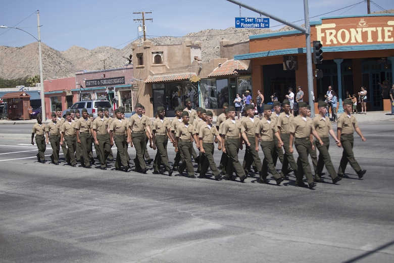 Marines with the Marine Corps Communication-Electronics School, march during the annual Grubstake Days Parade in Yucca Valley, Calif., May 28, 2016. The parade was held as part of Yucca Valley's Annual Grubstake Days, a festival held to embrace the mining heritage of the Yucca Valley community. (Official Marine Corps photo by Cpl. Medina Ayala-Lo/Released)