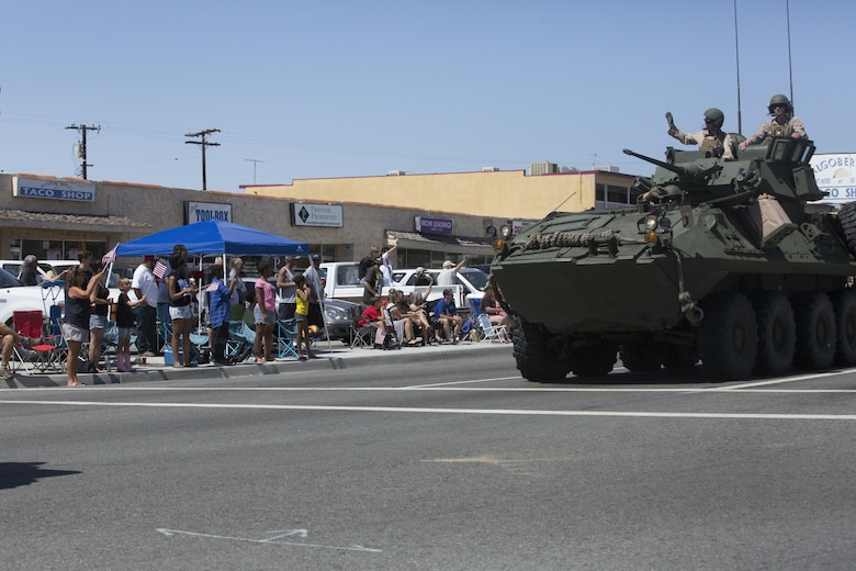 Marines with 3rd Light Armored Reconnaissance Battalion wave to parade spectators during the annual Grubstake Days Parade in Yucca Valley, Calif., May 28, 2016. The parade was held as part of Yucca Valley's Annual Grubstake Days, a festival held to embrace the mining heritage of the Yucca Valley community. (Official Marine Corps photo by Cpl. Medina Ayala-Lo/Released)