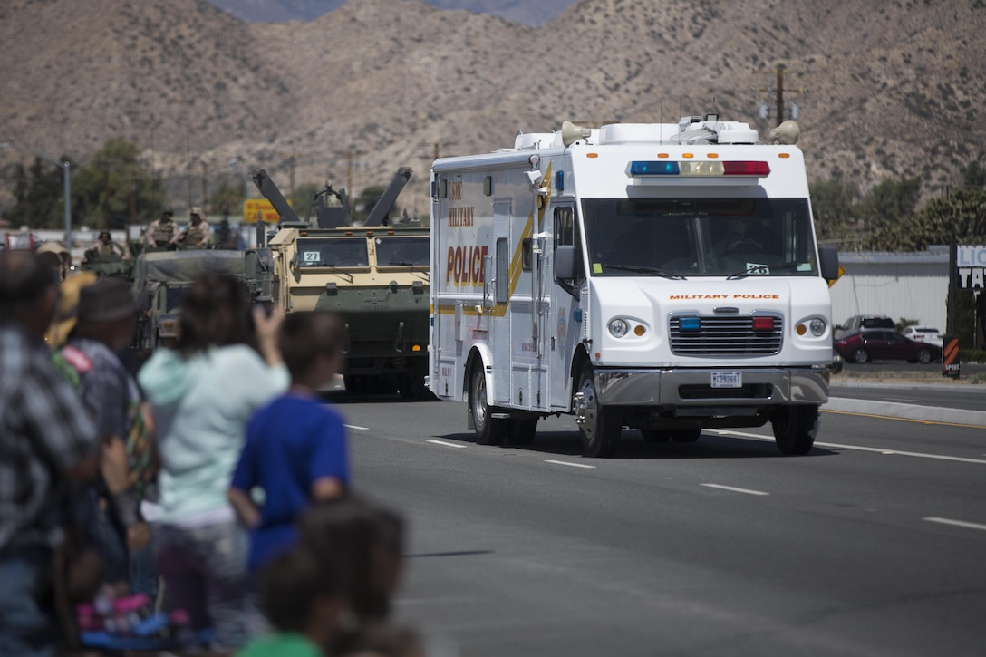 The Combat Center Provost Marshal's Office Mobile Command Post sounds it's siren for parade spectators during the annual Grubstake Days Parade in Yucca Valley, Calif., May 28, 2016. The parade was held as part of Yucca Valley's Annual Grubstake Days, a festival held to embrace the mining heritage of the Yucca Valley community. (Official Marine Corps photo by Cpl. Medina Ayala-Lo/Released)