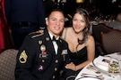 U.S. Army Reserve Staff Sgt. Angel Olivo, Information Technology Sergeant, and his wife, Juliette pause for a photo at the Armed Forces Ball at the Union League Club of Chicago, May 20, 2016. Maj. Gen. Charles Whittington Jr., Deputy Commanding General for Operations, First Army, was the keynote speaker for the event.