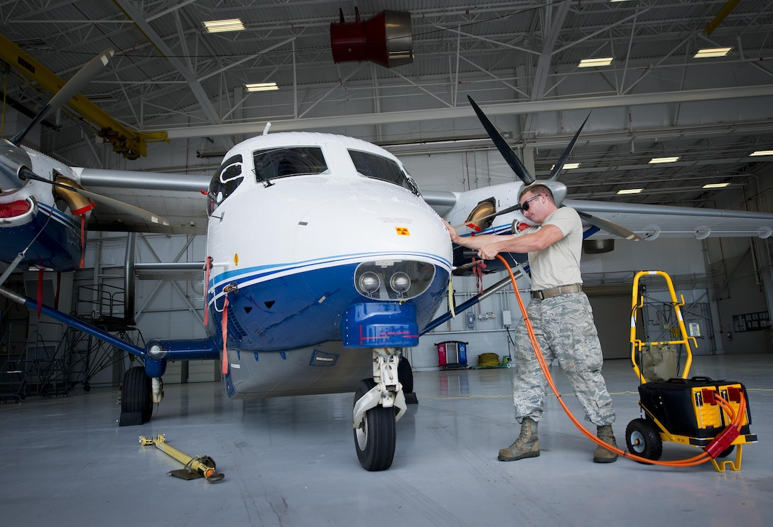 A 919th Special Operations Maintenance Group maintainer removes the external power from a C-145 at Duke Field, Fla.  More than a dozen Airmen from across the 919th Special Operations Wing were promoted in June. (U.S. Air Force photo/Tech. Sgt. Sam King)