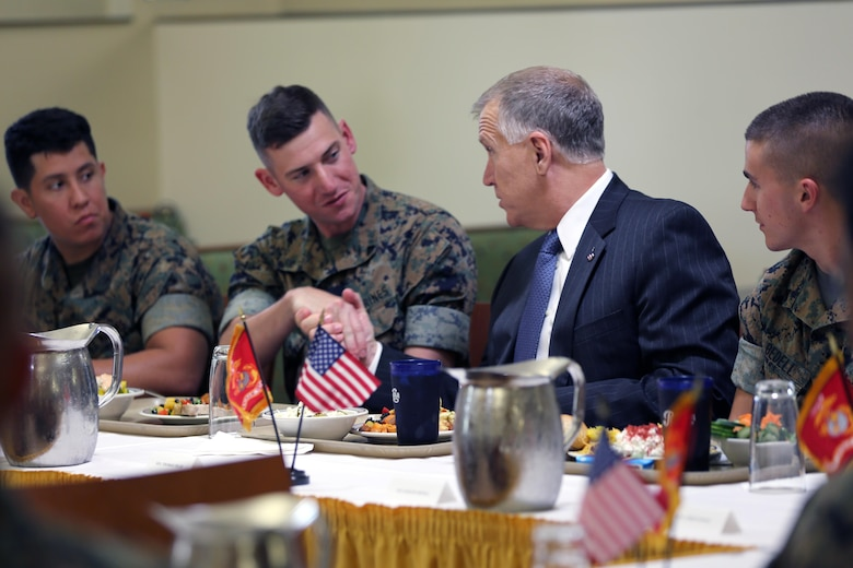 Sen. Thom Tillis, right, greets the Marines sharing a meal with him at the mess hall during a visit at Marine Corps Air Station Cherry Point, N.C., June 1, 2016. Tillis visited the air station to address the needs and priorities of the base, and assess the Marine Corps' presence in North Carolina. Tillis also toured Fleet Readiness Center East. Tillis is a North Carolina senator. (U.S. Marine Corps photo by Lance Cpl. Mackenzie Gibson/Released)