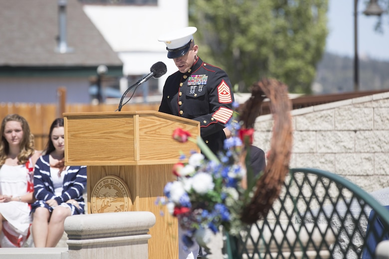 Sgt. Maj. Michael J. Hendges, Combat Center Sergeant Major, addresses ceremony attendees during the Memorial Day Ceremony in Veteran's Park at Big Bear Lake, Calif., May 30, 2016. Hendges represented the Combat Center as the guest speaker in the Memorial Day Ceremony spoke about the importance of remembering the ultimate sacrifice many American service members have paid. (Official Marine Corps photo by Cpl. Medina Ayala-Lo/Released)