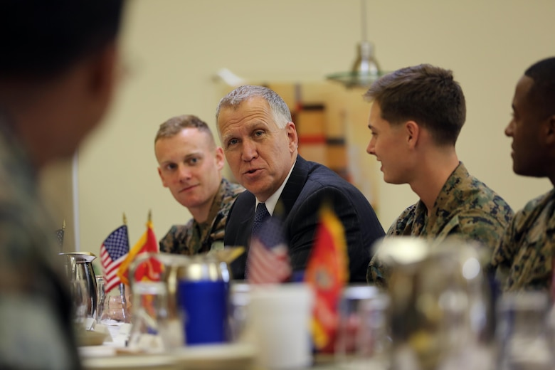 Sen. Thom Tillis speaks to Marines while sharing a meal at the mess hall during a visit at Marine Corps Air Station Cherry Point, N.C., June 1, 2016. Tillis visited the air station to address the needs and priorities of the base, and assess the Marine Corps' presence in North Carolina. Tillis also toured Fleet Readiness Center East. Tillis is a North Carolina senator. (U.S. Marine Corps photo by Lance Cpl. Mackenzie Gibson/Released)