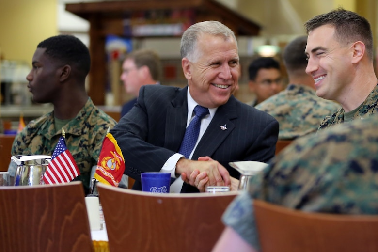Sen. Thom Tillis, left, meets a Marine while sharing a meal at the mess hall during a visit at Marine Corps Air Station Cherry Point, N.C., June 1, 2016. Tillis visited the air station to address the needs and priorities of the base, and assess the Marine Corps' presence in North Carolina. Tillis also toured Fleet Readiness Center East. Tillis is a North Carolina senator. (U.S. Marine Corps photo by Lance Cpl. Mackenzie Gibson/Released)