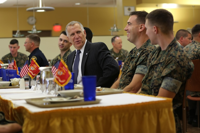 Sen. Thom Tillis shares a meal with Marines at the mess hall during a visit at MCAS Cherry Point, N.C., June 1, 2016. Tillis visited the air station to address the needs and priorities of the base, and assess the Marine Corps' presence in North Carolina. Tillis also toured Fleet Readiness Center East. Tillis is a North Carolina senator. (U.S. Marine Corps photo by Lance Cpl. Mackenzie Gibson/Released)