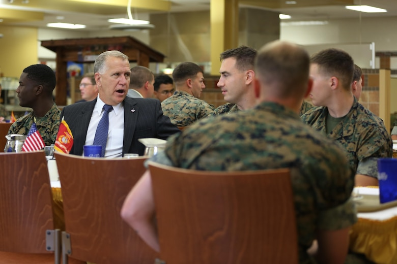 Sen. Thom Tillis, left, shares a meal with Marines at the mess hall during a visit at Marine Corps Air Station Cherry Point, N.C., June 1, 2016. Tillis visited the air station to address the needs and priorities of the base, and assess the Marine Corps' presence in North Carolina. Tillis also toured Fleet Readiness Center East. Tillis is a North Carolina senator. (U.S. Marine Corps photo by Lance Cpl. Mackenzie Gibson/Released)