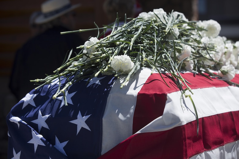 Carnations lay atop a casket as a sign of respect during the Memorial Day Ceremony in Veteran's Park at Big Bear Lake, Calif., May 30, 2016. Sgt. Maj. Michael J. Hendges, Combat Center Sergeant Major, represented the Combat Center as the guest speaker in the Memorial Day Ceremony spoke about the importance of remembering the ultimate sacrifice many American service members have paid. (Official Marine Corps photo by Cpl. Medina Ayala-Lo/Released)