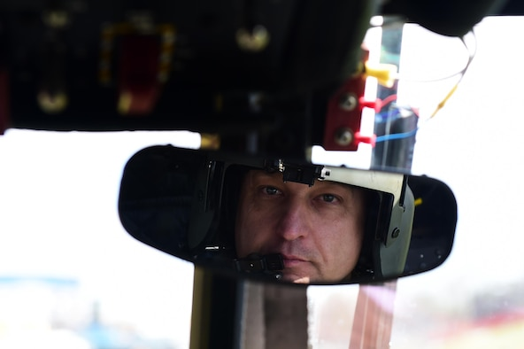 U.S. Army Chief Warrant Officer 4 Ronald Trani, Bravo Company 2-135th General Support Aviation Battalion CH-47 Chinook senior instructor pilot, looks into a rearview mirror April 1, 2016, at the Colorado School of Mines in Golden, Colo. Instructor pilots are responsible for training pilots on base mission tasks and upgrading them from readiness level one to readiness level three. (U.S. Air Force photo by Airman 1st Class Gabrielle Spradling/Released)