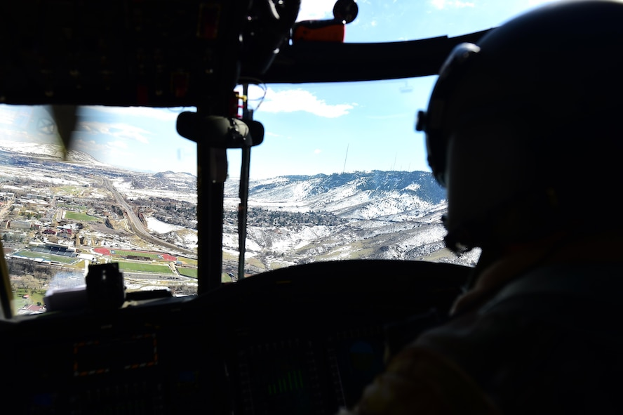 U.S. Army Chief Warrant Officer 4 Ronald Trani, Bravo Company 2-135th General Support Aviation Battalion CH-47 Chinook senior instructor pilot, flies through a passApril 1, 2016, during a flight over Denver. Instructor pilots administer check rides to pilots to ensure safety standards are met. (U.S. Air Force photo by Airman 1st Class Gabrielle Spradling/Released)
