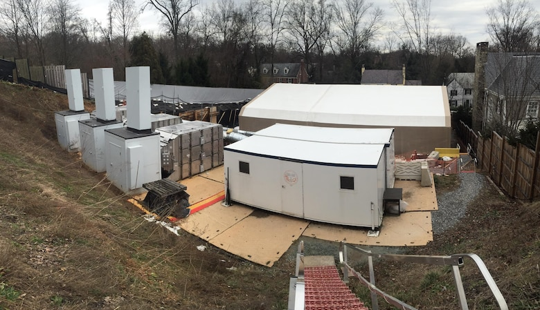 The Engineering Control Structure, the tan tent, and other aspects of the multi-layered approach to public safety the U.S. Army Corps of Engineers had in place during high probability operations at the 4825 Glenbrook Road cleanup effort are visible among the homes in the Spring Valley neighborhood in Washington, D.C., February 4, 2016. Public safety was the top priority at the site and with the multiple safety protocols in place, high probability operations searching for remnants of past military activity at the site resumed later that month.