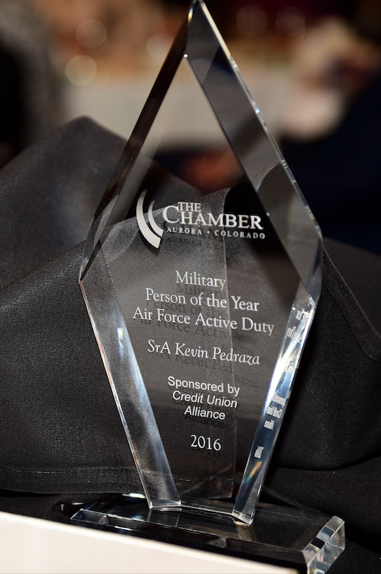 Local Colorado businesses present Service members with trophies May 13, 2016 during the annual Armed Forces Recognition Luncheon at the Doubletree Stapleton Hotel in Denver. Commanders and units worked with the Aurora Chamber of Commerce to select the top junior enlisted Army, Navy, Marine Corps, Air Force, and Coast Guard Service members. (U.S. Air Force photo by Airman 1st Class Gabrielle Spradling/Released)